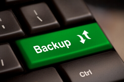 "Enter key on a computer keyboard with the word ""Backup"" on it"