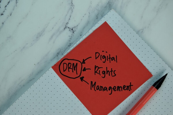 """""""DRM - Digital Rights Management"""" written on a sticky note"""